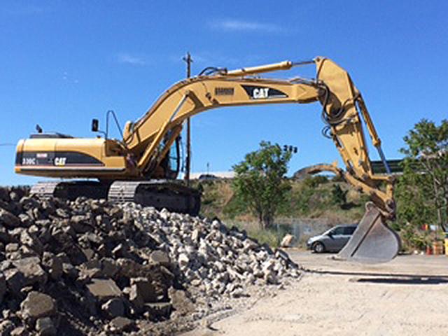 Excavator During Demolition